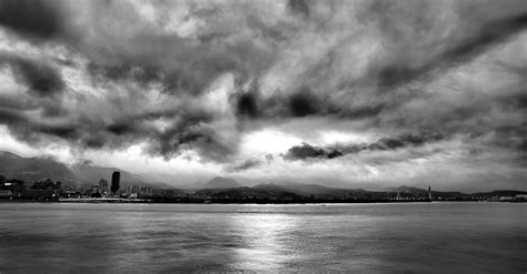 overcast sky 1920 x 1200 water photography grayscale photo of calm body of water under cloudy sky