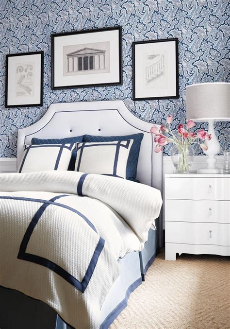 white comforter with blue trim bedroom with thibaut winchester paisley wallpaper in navy