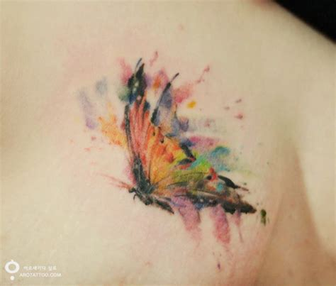 colorful flower tattoos that look like watercolor paintings