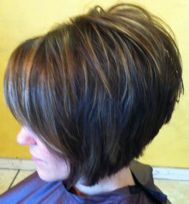 short cuts with carmel highlights rich brown base with caramel highlights cut into a short