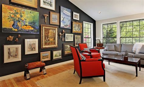 decorating with pictures come to the dark side displaying artwork on black walls