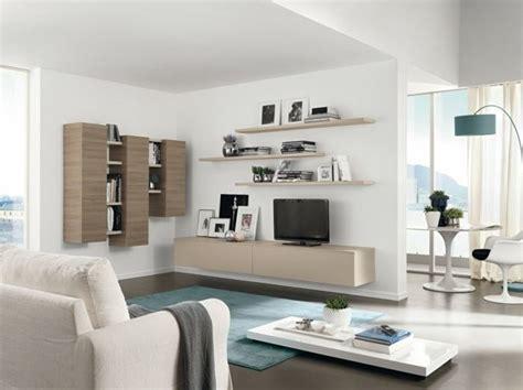 wohnzimmer einrichten beispiele wohnzimmer einrichten beispiele blauer teppich stauraum