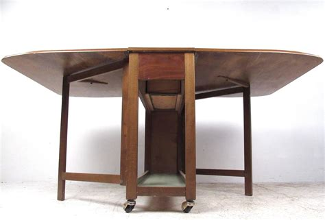 Dining Table With Rolling Chairs Mid Century Modern Rolling Drop Leaf Table With Chairs For Sale At 1stdibs