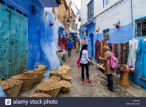 blue city morocco chair street life in the medina chefchaouen morocco stock