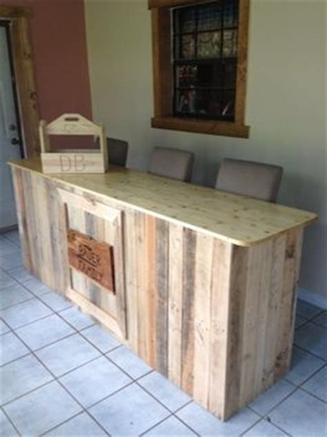 spar urethane bar top it is a moveable bar of old wooden pallets the top is