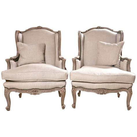 Wingback Chair Upholstery by Pair Of Wingback Chairs In Linen Upholstery With