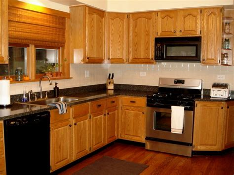 black wood kitchen cabinets light wood kitchen cabinets with black countertops