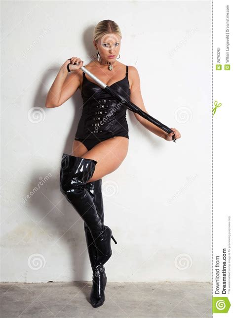 stock image beautiful woman  high heels holding  whip