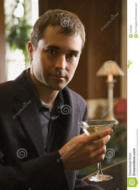 man holding martini man drinking martini stock photography image 2425822
