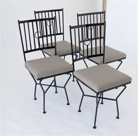set of four swivel wrought iron patio dining chairs for