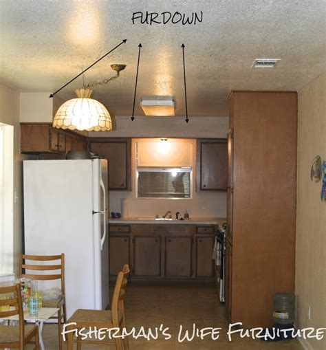space between kitchen cabinets and ceiling fisherman s wife furniture covering fur down the space