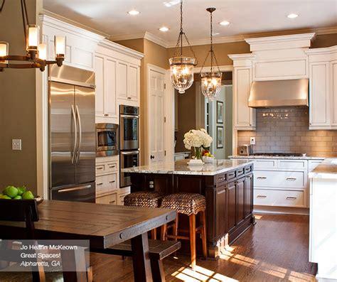 white kitchen dark island off white glazed cabinets and dark kitchen island