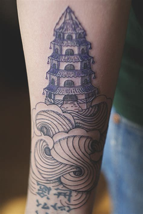 pagoda tattoo pagoda on arm best design ideas
