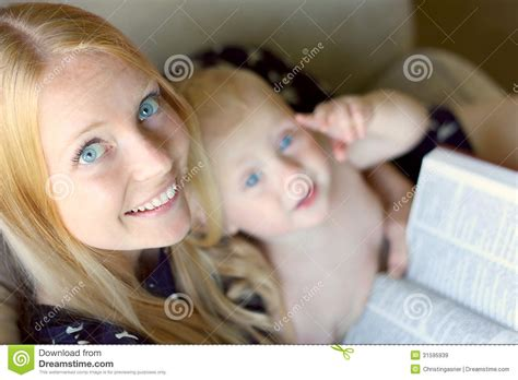 the babys lap book woman reading with baby on her lap royalty free stock images image 31595939