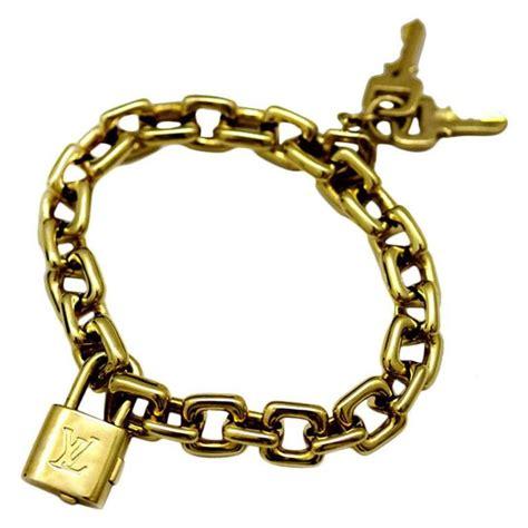L Is Vuitton Gold louis vuitton padlock and key gold charm bracelet for sale
