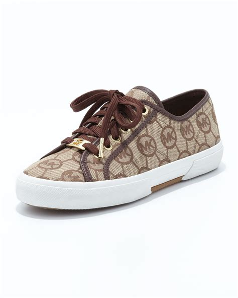 michael kors brown sneakers lyst michael michael kors monogram canvas sneaker in brown