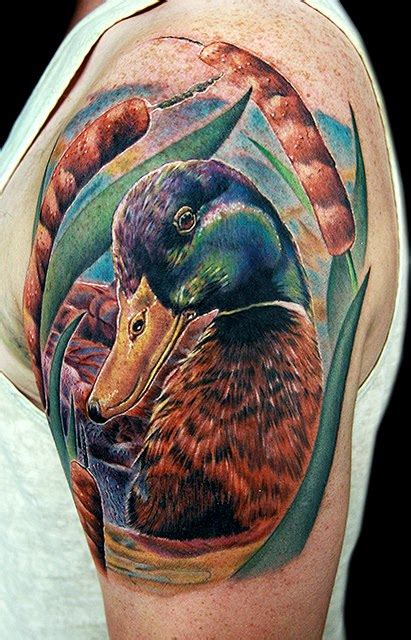 realistic color ink duck head tattoo on left shoulder