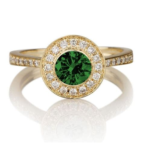 1 25 carat cut emerald and halo engagement