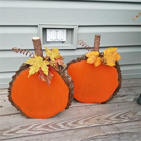 halloween decorations that you can make at home wood slice pumpkins crafty morning
