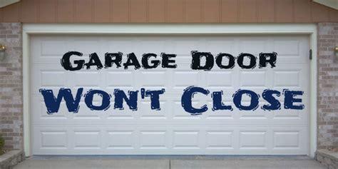 reasons garage door won t open or