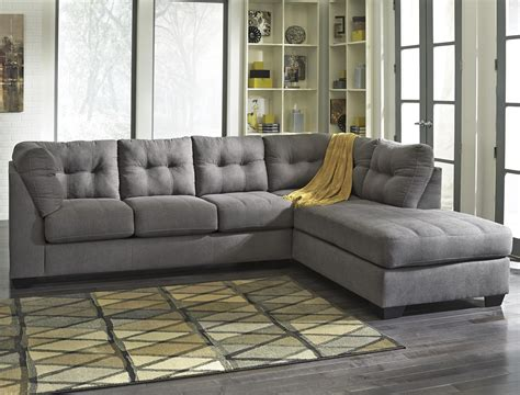 Sofas And Sectional Furniture Grey Sectional Couches Design With Area Rugs And Grey Wooden Floor For Living Room Design