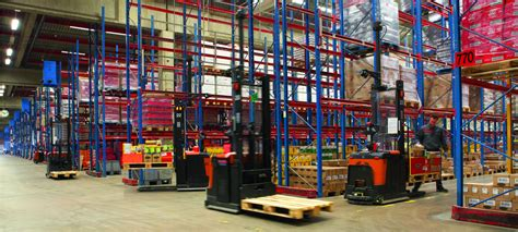 Toyota Distribution Center Realising The Benefits Of Automated Warehouse Trucks