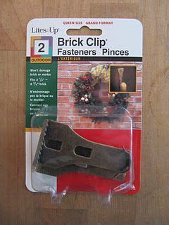 best hook for bricks omg finally a way to hang decor on brick walls you can move them around and they re