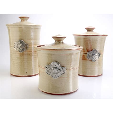 beach themed kitchen canisters fish 3 piece stoneware canister set in 4 colors beach