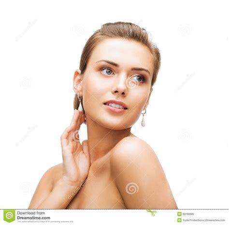 older women wearing jewelry woman wearing shiny diamond earrings royalty free stock