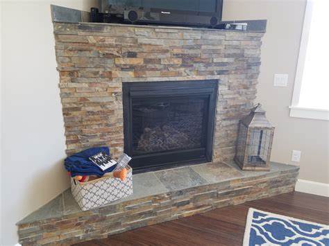 california gold ledger stone accent wall and fireplace