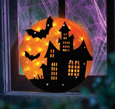 lighted haunted house silhouette window decor