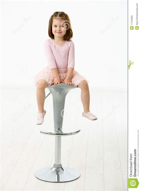 little girl on chair little girl sitting on chair stock photos image 17724363
