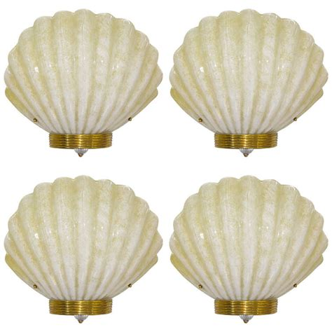 1970s deco style vintage shell sconces in gold and