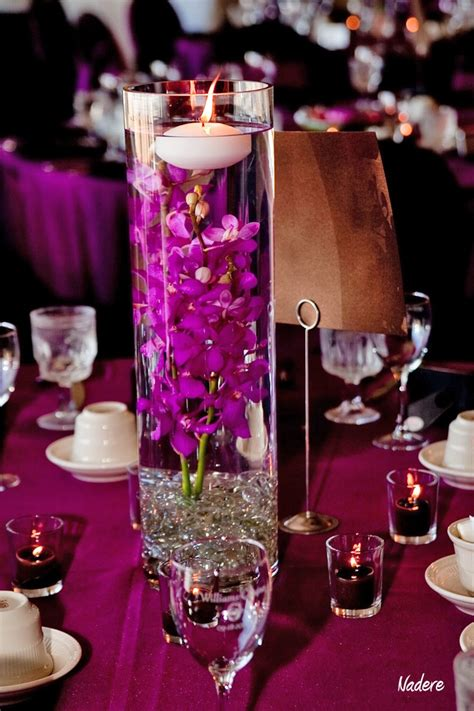 orchids wedding centerpieces submerged purple orchid and floating candle centerpiece wedding flower