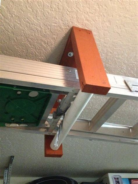 Ladder Storage Racks For Garage by Ceiling Mounted Ladder Rack Garage Ceiling Mounted