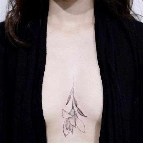 small boob tattoos sternum between the breast design ideas