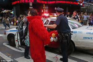 video shows how not to get arrested at cambodias angkor cookie monster arrested in times square for allegedly