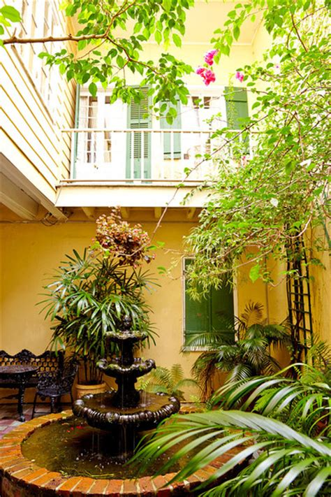 restoration of eclectic french quarter pied a terre in new orleans decor advisor courtyard photos design ideas remodel and decor lonny