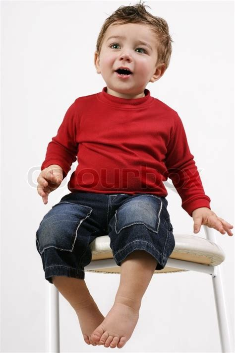 Pale Stools Toddler by Adorable Happy Toddler Child Sitting On A White Stool Stock Photo Colourbox