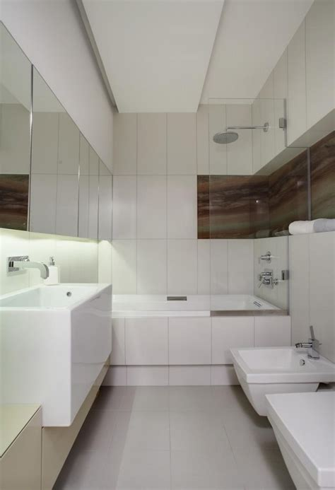 small bathroom white bathtub shower glass wall led home