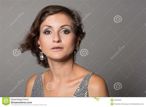 Pic Of 36 Yr Old Woman With Grey Hair | portrait woman on a gray stock photo image 45509320