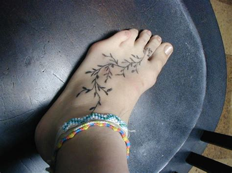 elegant foot tattoo designs vine plant on foot for