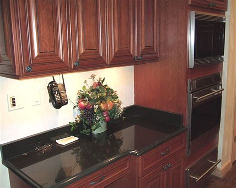 cherry cabinets with granite countertops maple cabinets
