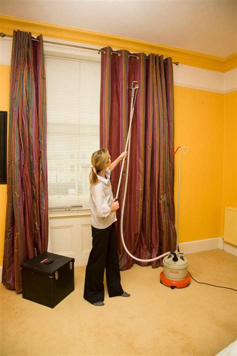 steaming curtains drapery kit in use on curtains with steamer and carry case
