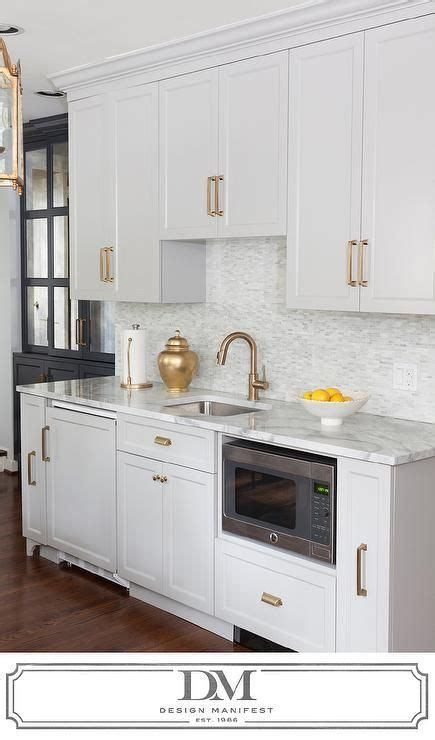 light gray kitchen cabinets transitional kitchen light gray cabinets with gray quartzite countertops