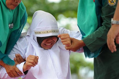 unmarried couples  indonesia publicly caned
