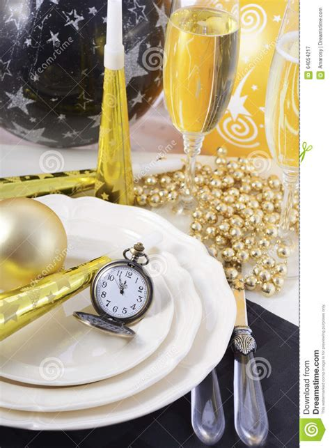 new year dinner place new years dinner table place setting stock photo