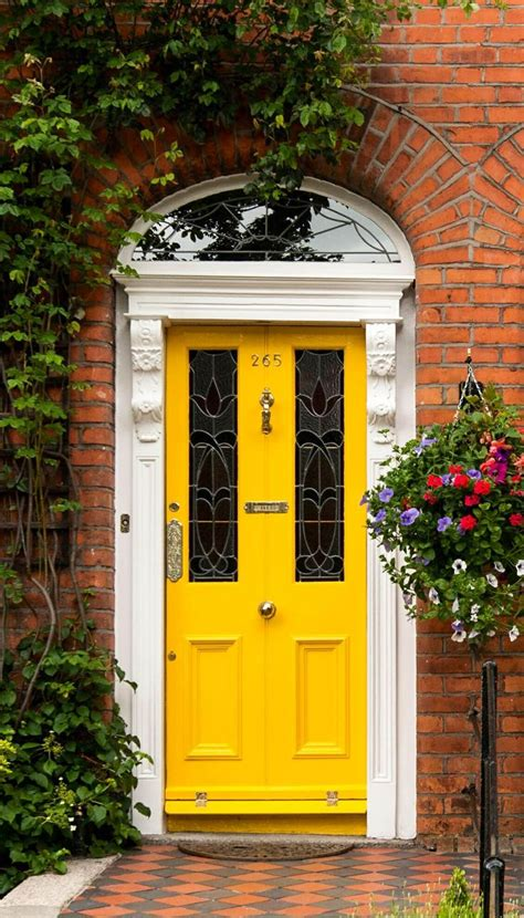 yellow front door you guessed it the perfect front door can make or break