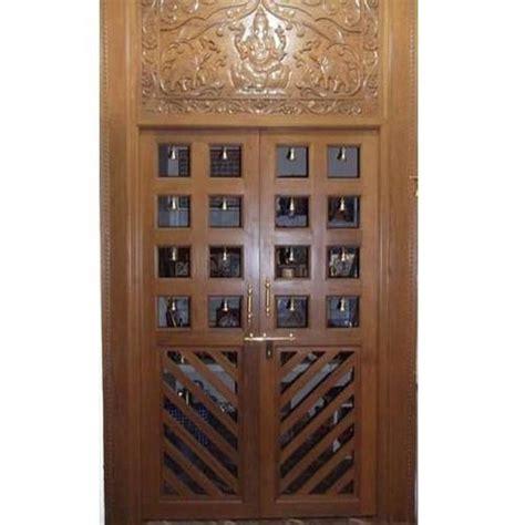 design of pooja room door teak wood puja room door 500x500 jpg 500 215 500 pooja