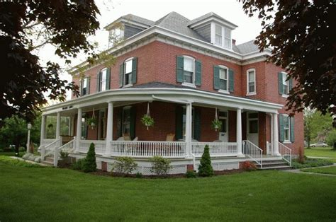 colonial farmhouse with wrap around porch wrap around porch and red brick home pinterest
